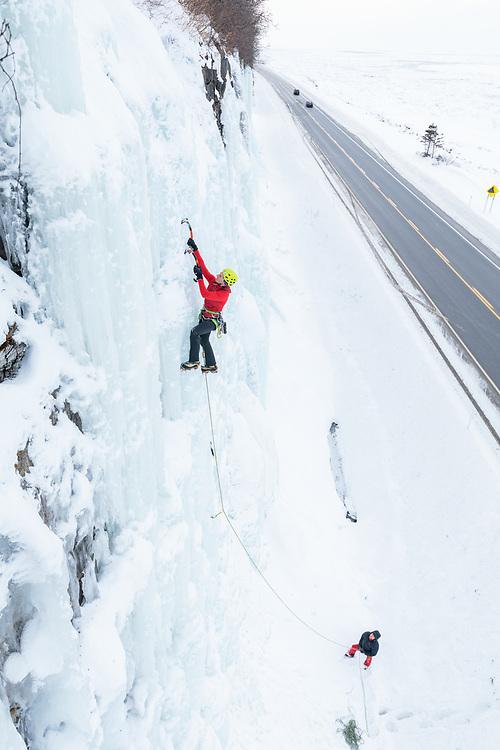 Nathalie Forton climbing road side ice in Gaspesie, Quebec
