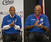 NBA legends T.J. Ford, left, and Clyde Drexler, right, participate in a financial education and success program sponsored by NBA Cares and BBVA Compass at Crespo Elementary School, February 27, 2014.