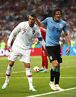 (180630) -- SOCHI, June 30, 2018 -- Portugal s Cristiano Ronaldo (L) helps injured Uruguay s Edinson Cavani walking out of the pitch during the 2018 FIFA World Cup WM Weltmeisterschaft Fussball round of 16 match between Uruguay and Portugal in Sochi, Russia, June 30, 2018. Uruguay won 2-1 and advanced to the quarter-final. ) (SP)RUSSIA-SOCHI-2018 WORLD CUP-ROUND OF 16-URUGUAY VS PORTUGAL YexPingfan PUBLICATIONxNOTxINxCHN