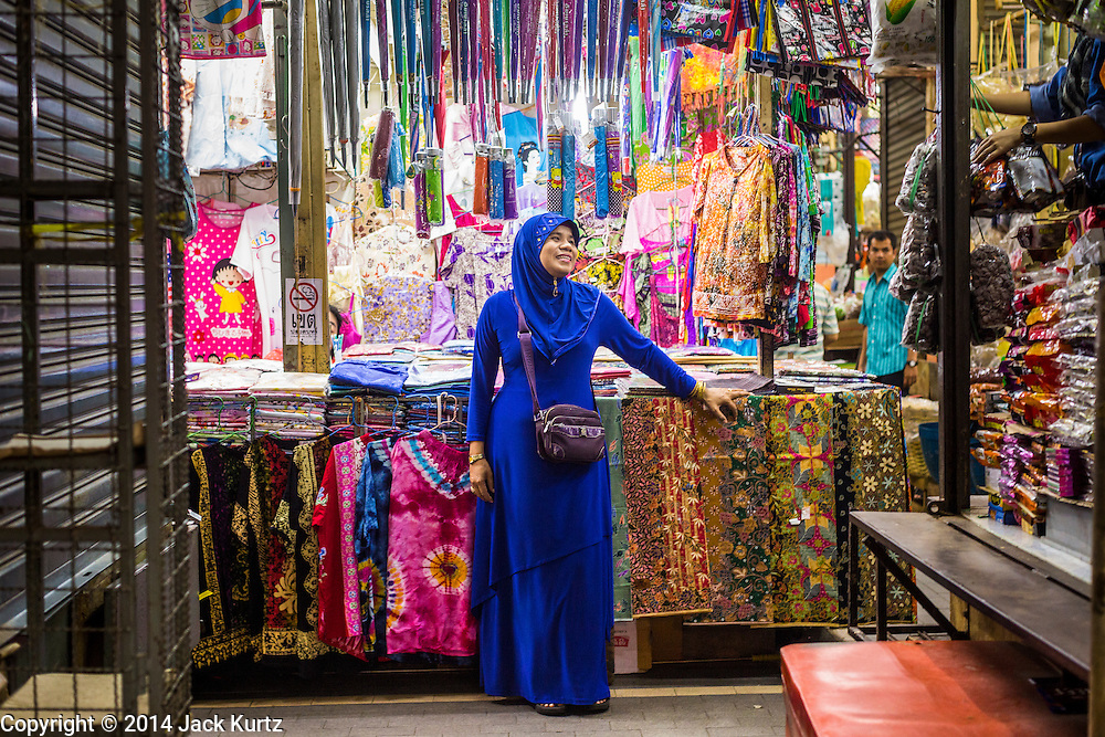 29 JULY 2014 - HAT YAI, SONGKHLA, THAILAND: A Muslim clothing vendor in the market in Hat Yai. Hat Yai is the 4th largest city in Thailand and the largest outside of the Bangkok metropolitan area. It's less the 50 miles from the Malaysian border and is a popular vacation spot for Malaysian and Singaporean tourists.       PHOTO BY JACK KURTZ