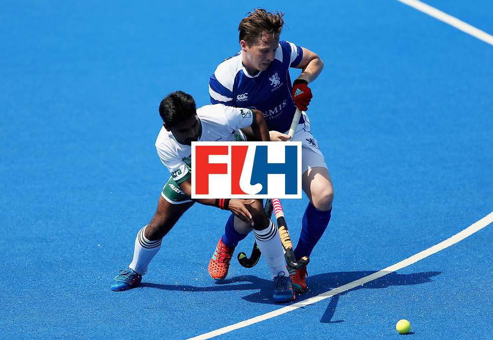 LONDON, ENGLAND - JUNE 19: Muhammad Dilber of Pakistan and David Forsyth of Scotland battle for possession during the Pool B match between Scotland and Pakistan on day five of Hero Hockey World League Semi-Final at Lee Valley Hockey and Tennis Centre on June 19, 2017 in London, England.  (Photo by Alex Morton/Getty Images)