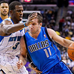 November 17, 2010; New Orleans, LA, USA; New Orleans Hornets point guard Chris Paul (3) defends Dallas Mavericks point guard Jose Juan Barea (11) during the first half at the New Orleans Arena. Mandatory Credit: Derick E. Hingle
