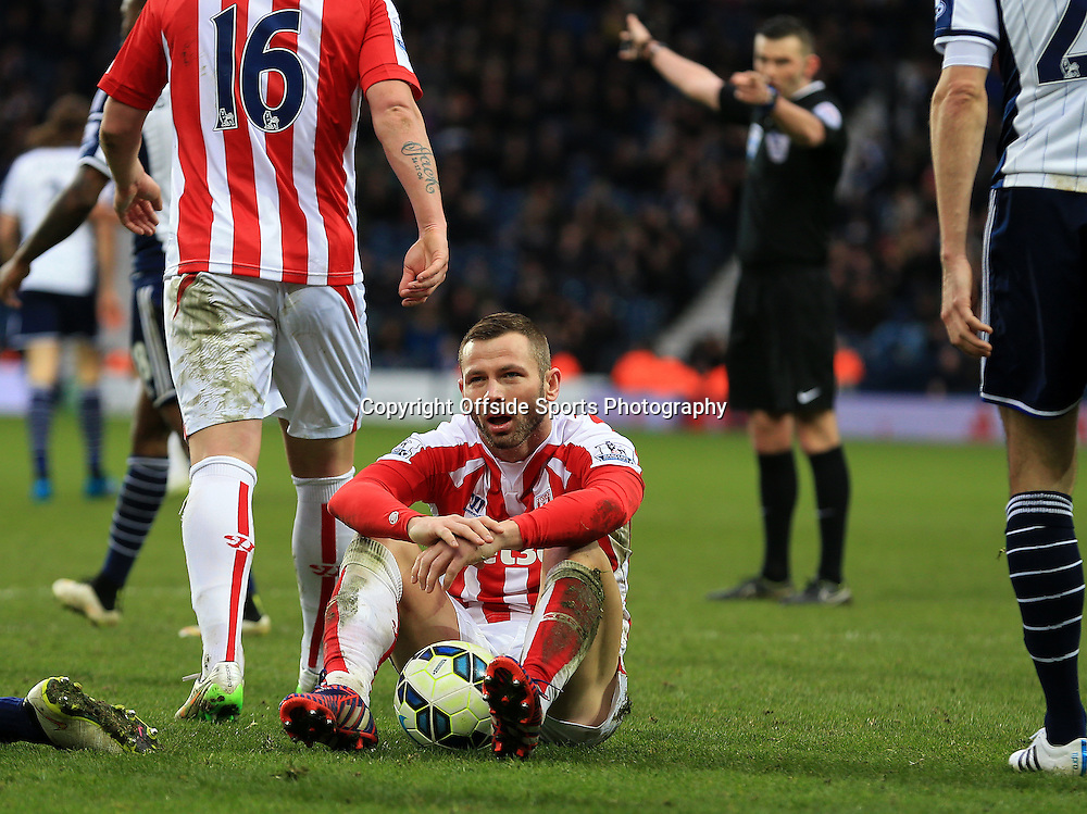 14th March 2015 - Barclays Premier League - West Bromwich Albion v Stoke City - Marc Wilson of Stoke City looks dejected as the match slips away from the visitors - Photo: Paul Roberts / Offside.