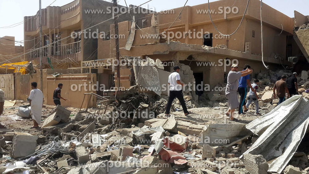 People gather near a damaged building after Iraqi Air Force bombing in Islamic State (IS) militants-seized city of Fallujah, some 50 km west of Baghdad, Iraq, June 11, 2015. At least four citizen were killed and seven others wounded during the bombing on Thursday. EXPA Pictures &copy; 2015, PhotoCredit: EXPA/ Photoshot/ Sami Jawad<br /> <br /> *****ATTENTION - for AUT, SLO, CRO, SRB, BIH, MAZ only*****