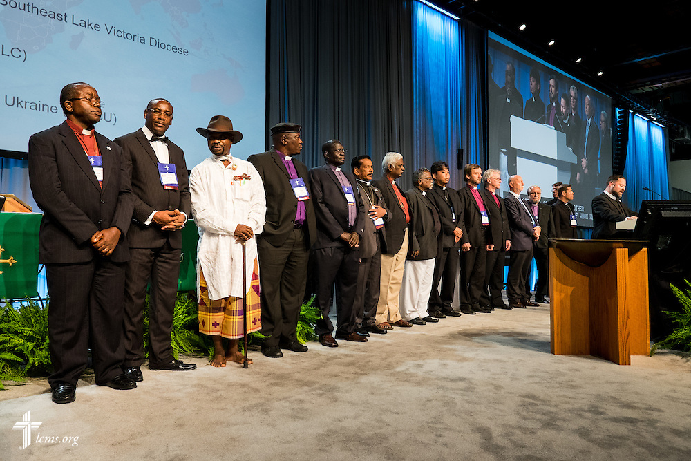 Participating in a special recognition of the LCMS' growing partnerships with churches around the world are, from left, the Rev. Amos Bolay (Evangelical Lutheran Church in Liberia), the Most Rev. Christian Ekong (Lutheran Church of Nigeria), the Rev. Modise Maragelo (Lutheran Church in Southern Africa), Rev. S. Rajagambeeram (India Evangelical Lutheran Church), Rev. Dr. J. Samuel (India Evangelical Lutheran Church), Rev. Dr. D. Monikaraj (Concordia Theological Seminary, India), Rev. Tatsuomi Yoshida (Japan Lutheran Church), Rt. Rev. Janis Vanags (Evangelical Lutheran Church of Latvia), Rev. Torkild Masvie (Lutheran Church in Norway), Rev. Adalberto Hiller (Portuguese Evangelical Lutheran Church) and Rt. Rev. Arri Kugappi (Evangelical Lutheran Church of Ingria in Russia), on Tuesday, July 12, 2016, at the 66th Regular Convention of The Lutheran Church–Missouri Synod, in Milwaukee. LCMS/Michael Schuermann