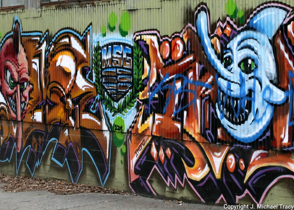 Colorful Urban Artwork, Grafitti, painted on a tin outside wall of an abandoned building in Urban Atlanta.