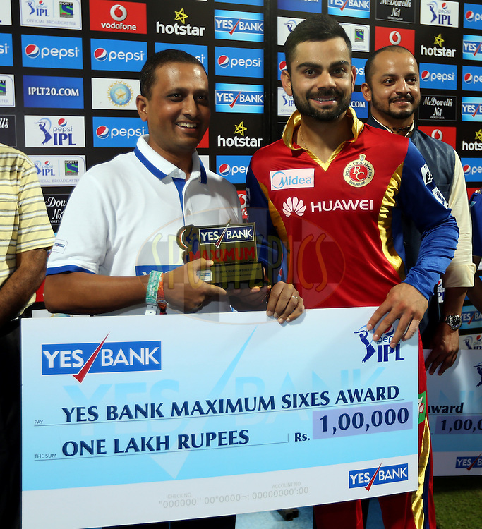 Royal Challengers Bangalore captain Virat Kohli player receives Yes Bank Maximum sixes award during the presentation of the match 46 of the Pepsi IPL 2015 (Indian Premier League) between The Mumbai Indians and The Royal Challengers Bangalore held at the Wankhede Stadium in Mumbai, India on the 10th May 2015.<br /> <br /> Photo by:  Sandeep Shetty / SPORTZPICS / IPL