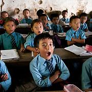 Nepal 2014. Arun Valley. Khandbari primary school. Yawning boy.