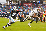 NASHVILLE, TN - NOVEMBER 29:  Seth Roberts #10 of the Oakland Raiders catches a pass in front of Coty Sensabaugh #24 of the Tennessee Titans at Nissan Stadium on November 29, 2015 in Nashville, Tennessee.  The Raiders defeated the Titans 24-21.  (Photo by Wesley Hitt/Getty Images) *** Local Caption *** Seth Roberts; Coty Sensabaugh