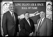 Garden City, NY, USA. June 21, 2018. At Long Island Air & Space Hall of Fame Class of 2018 Induction, L-R. inductee Astronaut MIKE MASSIMINO; DEBORAH HENLEY, VP (Executive Editor of Newsday), representing inductee Alicia Patterson; and LOUIS MANCUSO JR, representing his parents, inductees Louis and Carol Mancuso, pose at Cradle of Aviation Museum. (© 2018 Ann Parry/Ann-Parry.com)