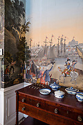 The dining room of the Fraunces Tavern Museum, with wallpaper by Zuber & Cie., showing battle scenes from the American Revolution.