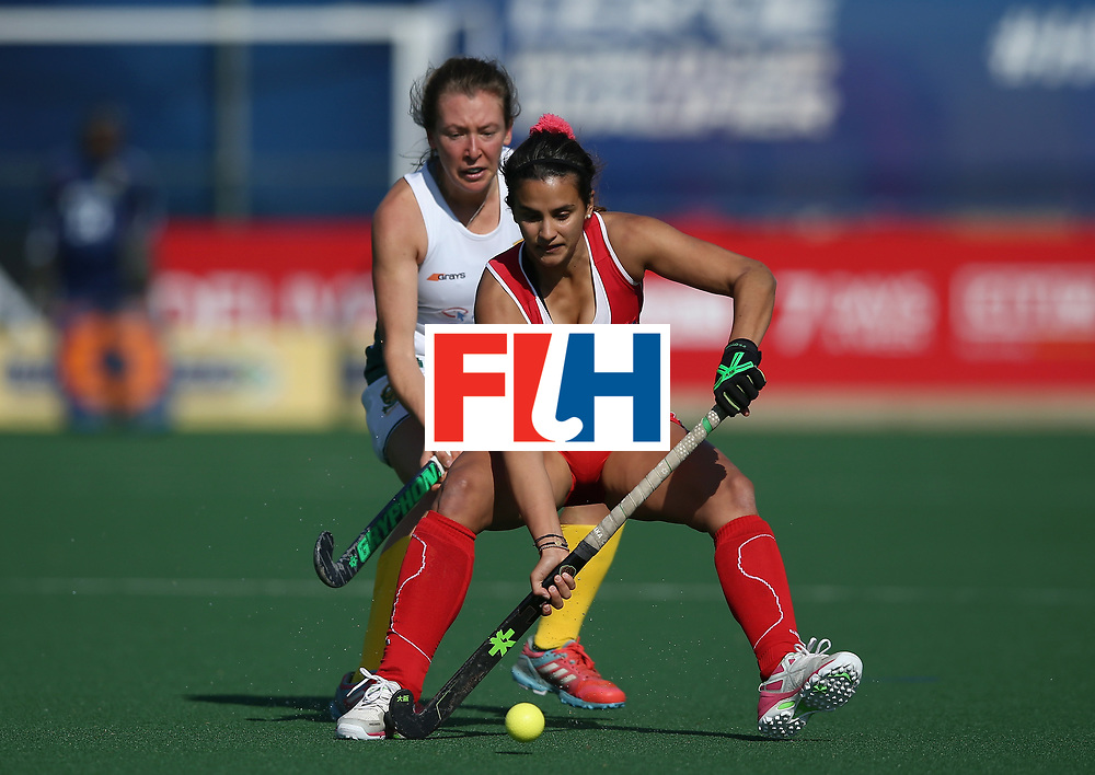 JOHANNESBURG, SOUTH AFRICA - JULY 14: Manuela Urroz of Chile and Celia Evans of South Africa battle for possession during day 4 of the FIH Hockey World League Semi Finals Pool B match between Chile and South Africa at Wits University on July 14, 2017 in Johannesburg, South Africa. (Photo by Jan Kruger/Getty Images for FIH)