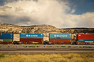 The Burlington Northern Santa Fe railroad line flirts with a large swath of US Route 66 West of Albuquerque, NM, on to Los Angeles. Freight cars head West on the double track near Gallup, NM as seen from US Route 66.
