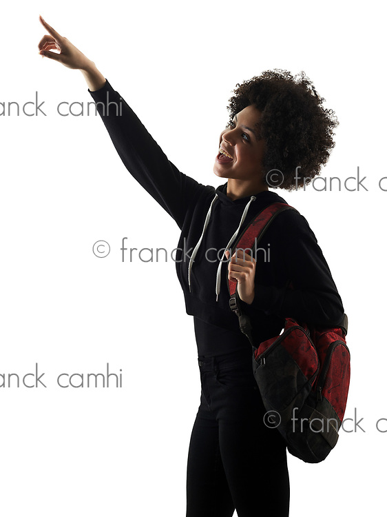 one mixed race african young teenager girl woman looking up pointing  in studio shadow silhouette isolated on white background