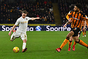 Leeds United player Adam Forshaw (4) crosses ball against Hull City defender Michael Hector (5)during the EFL Sky Bet Championship match between Hull City and Leeds United at the KCOM Stadium, Kingston upon Hull, England on 30 January 2018. Photo by Ian Lyall.