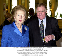 BARONESS THATCHER and SIR BERNARD INGHAM, at a luncheon in London on 24th April 2002.	OZI 13