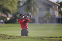 February 25, 2018 - Palm Beach Gardens, Florida, U.S. - Tiger Woods hits out of a bunker on the 18th hole during the final round of the 2018 Honda Classic at PGA National Resort and Spa in Palm Beach Gardens, Fla., on Sunday, February 25, 2018. (Credit Image: © Andres Leiva/The Palm Beach Post via ZUMA Wire)