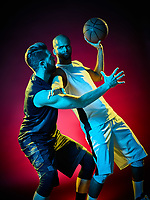two basketball players men Isolated on black background