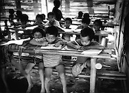 Internally displaced Karen boys study in refugee camp school near the border with Thailand Camp Ei Tu Ta, Burma (Myanmar).  Their families have venture from 7 to 14 days, dodging Myanmar military patrols and landmines, to reach this refugee camp.