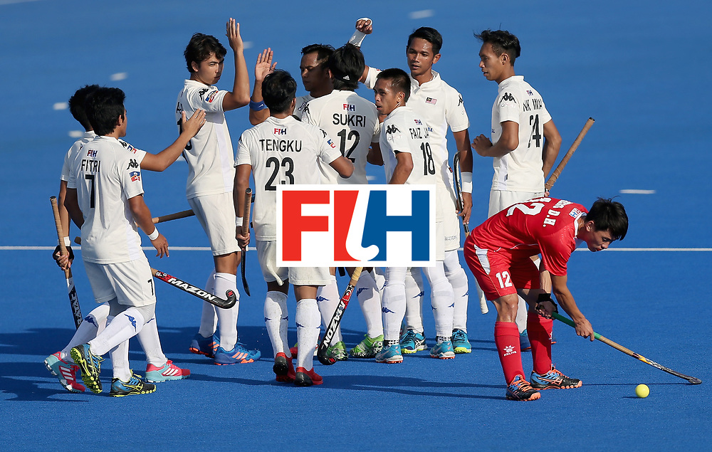 LONDON, ENGLAND - JUNE 20: Razie Rahim of Malaysia celebrtes scoring his sides third goal with his Malaysia team mates during the Pool A match between China and Malaysia on day six of the Hero Hockey World League Semi-Final at Lee Valley Hockey and Tennis Centre on June 20, 2017 in London, England.  (Photo by Alex Morton/Getty Images)