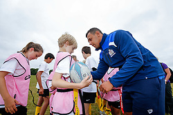 Ben Glynn of Bristol Rugby signs his teams shirt as Local Junior Schools compete in a Tag Rugby Competion - Mandatory byline: Rogan Thomson/JMP - 07966 386802 - 14/07/2015 - SPORT - RUGBY UNION - Bristol, England - Durdham Downs -  Webb Ellis Cup visits Bristol as part of the 2015 Rugby World Cup Trophy Tour