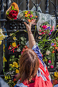 People add flowers to the memorial of the the killing this week in Parliament Square - Unite for Europe march attended by thousands on the weekend before Theresa May triggers article 50. The march went from Park Lane via Whitehall and concluded with speeches in Parliament Square.
