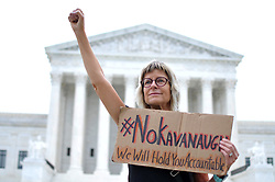 October 6, 2018 - Washington, District of Columbia, U.S. - The fist of Carolin Harding, of Columbus, OH, goes up in protest as protests gather at the US Supreme Court to protest the expected nomination of Judge Brett Kavanaugh, in Washington, D.C.. (Credit Image: © Bastiaan Slabbers/NurPhoto/ZUMA Press)