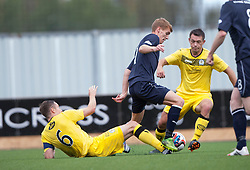 Queen of the South's Chris Higgins, Falkirk's Jay Fulton andQueen of the South's Derek Young.<br /> half time : Falkirk 1 v 0 Queen of the South, Scottish Championship 5/10/2013.<br /> &copy;Michael Schofield.