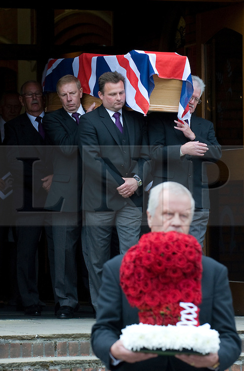 © licensed to London News Pictures. 18/05/2011. Tonbridge, UK. The coffin of heavyweight boxing legend Sir Henry Cooper leaving Corpus Christi Church in Lyons Crescent, Tonbridge, Kent today (18/05/2011).   Pictured in foreground is a boxing glove made from flowers. Please see special instructions for usage rates. Photo credit should read Ben Cawthra/LNP