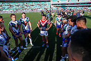 The Warriors huddle for the retiring Cooper Cronk. Sydney Roosters v Vodafone Warriors. NRL Rugby League. Sydney Cricket Ground, Sydney, Australia. 18th August 2019. Copyright Photo: David Neilson / www.photosport.nz