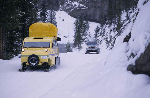 Yellowstone National Park, Snow coach taking people into park.
