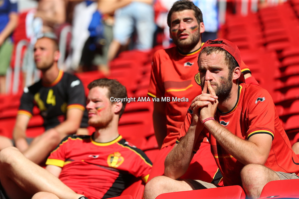 Dejected fans of Belgium at the end of the match in which Belgium got knocked out of the FIFA World Cup