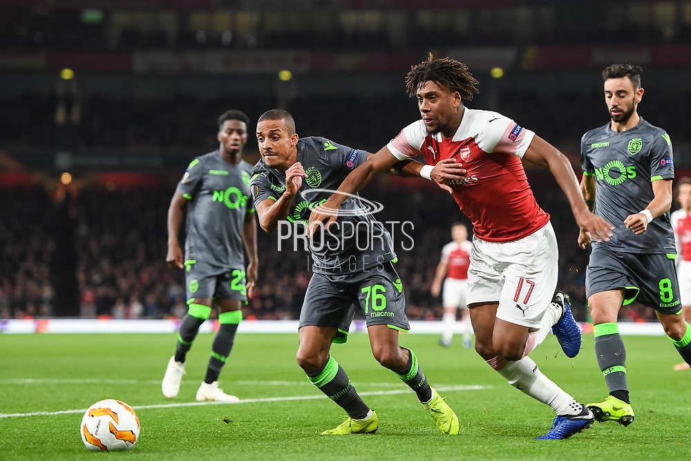 Arsenal Midfielder Alex Iwobi (17) and  Sporting Lisbon Defender Bruno Gaspar (76) battle for the ball during the Europa League group stage match between Arsenal and Sporting Lisbon at the Emirates Stadium, London, England on 8 November 2018.