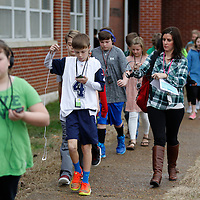 "Thomas Wells | Buy at PHOTOS.DJOURNAL.COM<br /> Daniel Whitfield tries to get his headphones worked out as he enjoys the ""walking classroom"" at Saltillo Elemnetary School."