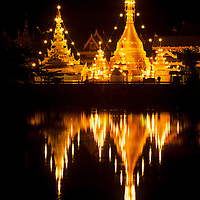 Wat Chong Kham temple lights are reflected in still reservoir, Mae Hong Son, Thailand