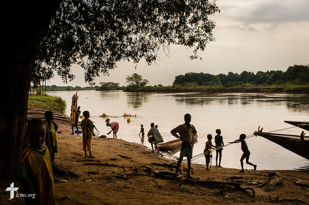 People gather at the Baro River on Saturday, Nov. 15, 2014, in Gambella, Ethiopia. LCMS Communications/Erik M. Lunsford