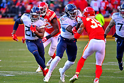 Jan 19, 2020; Kansas City, Missouri, USA; Tennessee Titans running back Derrick Henry (22) runs the ball against Kansas City Chiefs defensive end Tanoh Kpassagnon (92) during the first half in the AFC Championship Game at Arrowhead Stadium. Mandatory Credit: Denny Medley-USA TODAY Sports