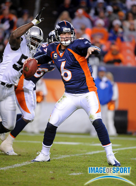 Nov 23, 2008; Denver, CO, USA; Denver Broncos quaterback Jay Cutler (6) throws a pass as Oakland Raiders defensive end Kalimba Edwards (58) pursues in the fourth quarter at Invesco Field. The Raiders defeated the Broncos 31-10.