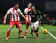 Tom Pett takes on the Stevenage defence during the Sky Bet League 2 match between Stevenage and Exeter City at the Lamex Stadium, Stevenage, England on 20 December 2014. Photo by Kieran Clarke.