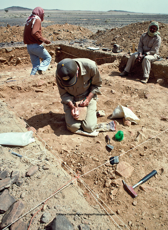 Dr. Ghanim Wahida archeology dept. King Saud University, Riyadh &Dr. Norman Whalen, dept. of archeology Southwest Texas State univ. excavating at al-Dawadimi a rock tool site of  Middle Acheulean artifacts.  Pleistocene.  Saudi Arabia
