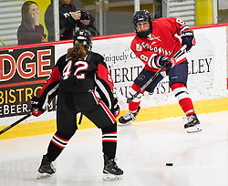 MOON TOWNSHIP, PA - SEPTEMBER 14:  Sarah Quaranta #8 of the Robert Morris Colonials makes a pass in front of Claire Dalton #42 of the Toronto Jr. Aeros in the first period during the game at the 84 Lumber Arena on September 23, 2016 in Moon Township, Pennsylvania. (Photo by Justin Berl)