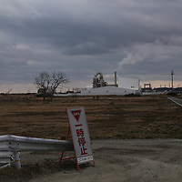 February,28.2016 Namie,fukushima prefecture,No entry  Zone, concentration camp facillity of Nuclear wastes with  radioactive monitoring post,close to nuclear plant, the facility gather nuclear wastes encircled by white walls  . Pierre  Boutier