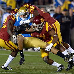 USC Trojans defense tackles UCLA Bruins tight end Caleb Wilson (81) in the second half of a NCAA college football game at the Rose Bowl in Pasadena, Calif., Saturday, Nov. 19, 2016. USC Trojans won 36-14.