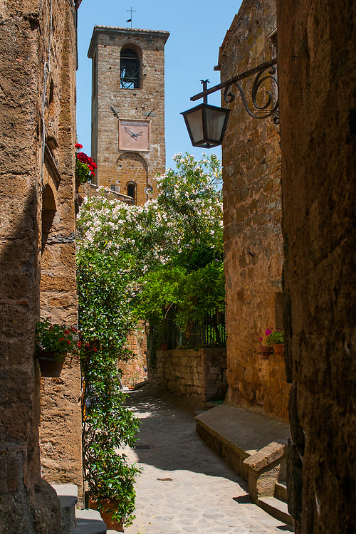 A view of the streets of the village of Civita di Bagnoregio.<br /> Civita di Bagnoregio is a town in the Province of Viterbo in central Italy, a suburb of the comune of Bagnoregio, 1 kilometre (0.6 mi) east from it. It is about 120 kilometres (75 mi) north of Rome. Civita was founded by Etruscans more than 2,500 years ago. Bagnoregio continues as a small but prosperous town, while Civita became known in Italian as La citt&agrave; che muore (&quot;The Dying Town&quot;). Civita has only recently been experiencing a tourist revival. The population today varies from about 7 people in winter to more than 100 in summer.The town was placed on the World Monuments Fund's 2006 Watch List of the 100 Most Endangered Sites, because of threats it faces from erosion and unregulated tourism.
