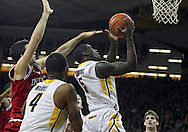 December 31 2012: Indiana Hoosiers forward Will Sheehey (0) tries to block a shot by Iowa Hawkeyes guard Anthony Clemmons (5) during the first half of the NCAA basketball game between the Indiana Hoosiers and the Iowa Hawkeyes at Carver-Hawkeye Arena in Iowa City, Iowa on Monday December 31, 2012. Indiana defeated Iowa 69-65.