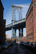 Empire state building seen through the Manhattan Bridge DUMBO Brooklyn NY USA