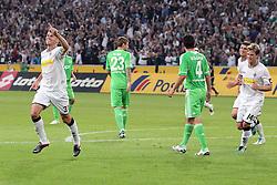 19.08.2011,  BorussiaPark, Mönchengladbach, GER, 1.FBL, Borussia Mönchengladbach vs Vfl Wolfsburg, im Bild.Torjubel / Jubel  nach dem 2:1 durch Filip Daems (Mönchengladbach #3) (L). in der Mitte Marcel Schäfer / Schaefer (Wolfsburg #4) und Marco Russ (Wolfsburg #23) entaeuscht / entäuscht / traurig ..// during the 1.FBL, Borussia Mönchengladbach vs Vfl Wolfsburg on 2011/08/19, BorussiaPark, Mönchengladbach, Germany. EXPA Pictures © 2011, PhotoCredit: EXPA/ nph/  Mueller *** Local Caption ***            ****** out of GER / CRO  / BEL ******
