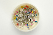 assortment of pins in a cup