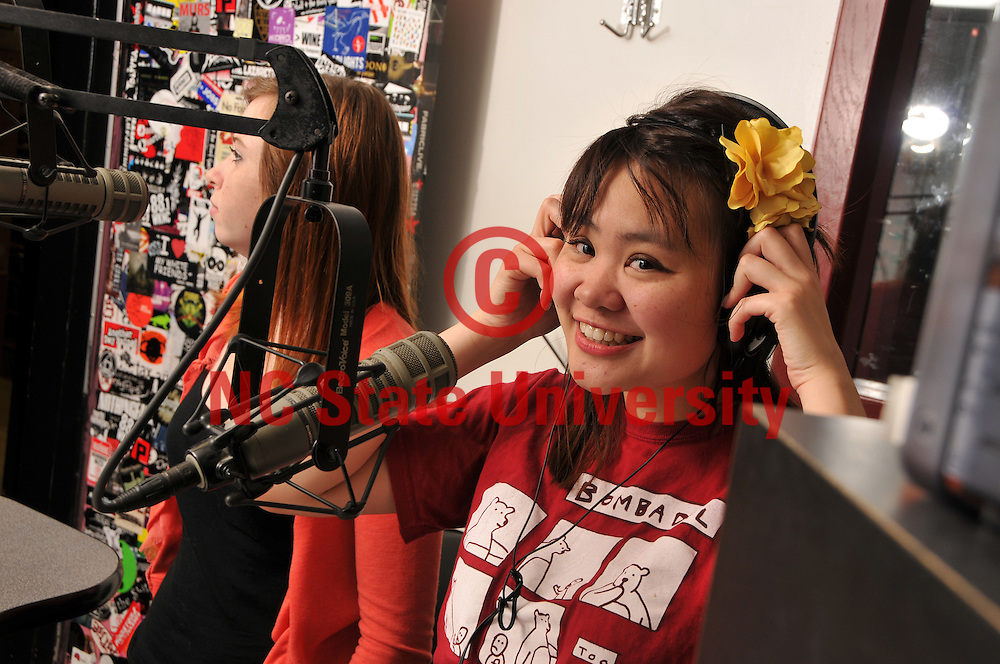 WKNC disc jockey May Chung readies to into the next song during her shift at the radio station.
