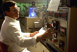 scientist using machinery in a labratory